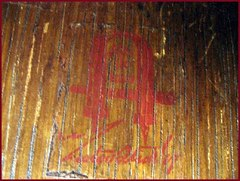 Gustav Stickley firm's red decal signature used from 1904-1912.